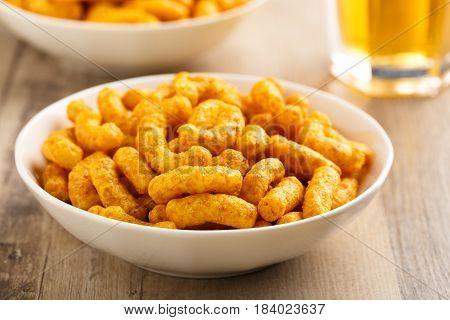 Crunchy peanut puffs in a small bowl