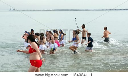people wearing swimwear in freezing water of Lake Michigan, Oak Street Beach, Chicago Polar Bear Club, January 30th, 2016