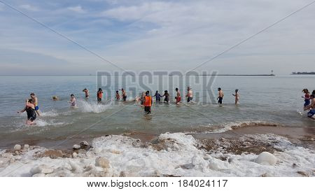 people in freezing water at Chicago Polar Bear Club, Oak Street Beach, January 30th, 2016