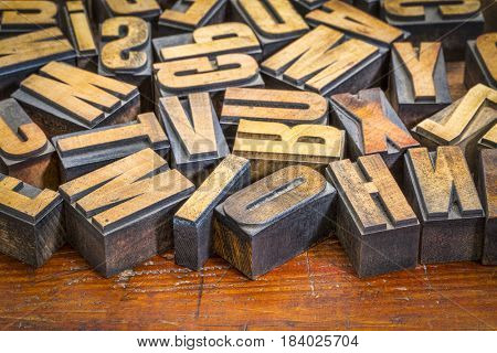 random vintage letterpress printing blocks on a grunge rustic wood