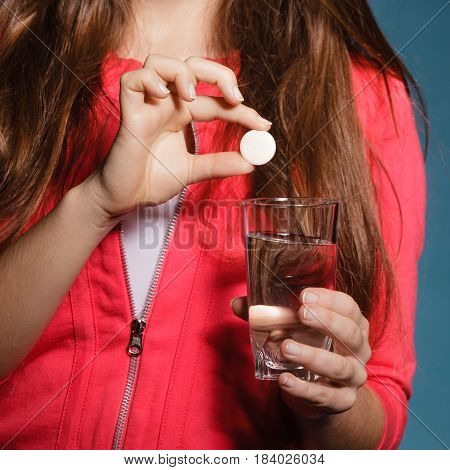 Human With Painkiller Pill And Water. Health Care.