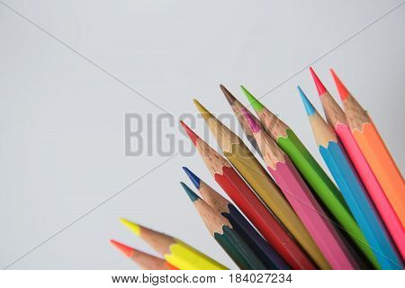 Colors pencils, colorful many crayons on white background .