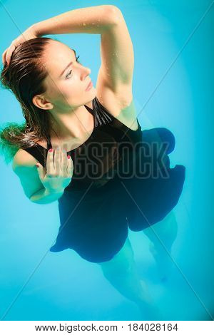Sexy Seductive Woman In Black Dress In Water.
