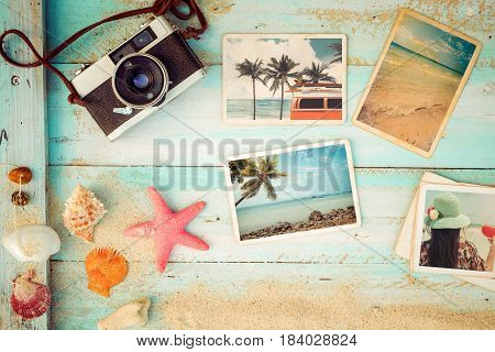 Top view composition - Summer photo album with starfish shells coral and items on wooden table. Concept of remembrance and nostalgia in summer tourism travel and vacation. vintage color tone.