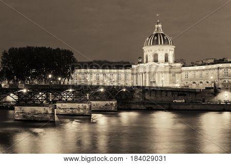 River Seine with Pont des Arts and Institut de France at night in Paris, France.