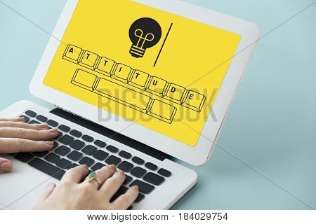 Attitude on keyboard with light bulb icon
