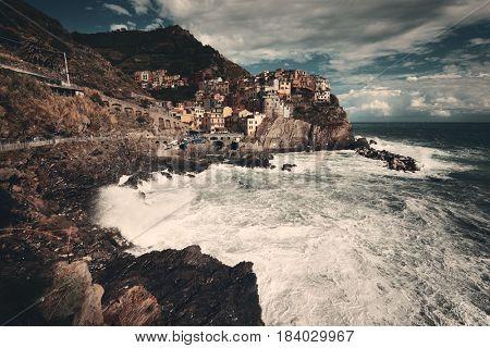 Manarola overlook Mediterranean Sea with buildings over cliff in Cinque Terre, Italy.
