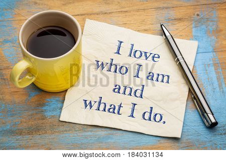 I love who I am and what I do - positive affirmation words on a napkin with a cup of coffee