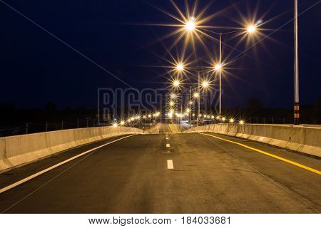 Paved roads and traffic lines Refreshing new at night