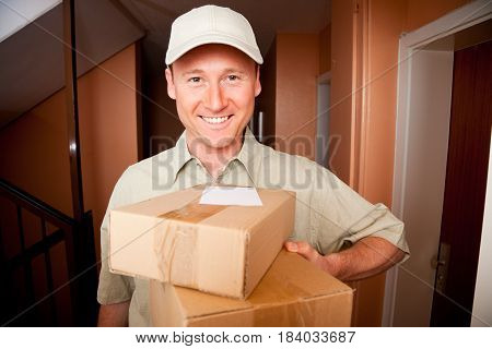 a delivery boy is standing in front of your door.