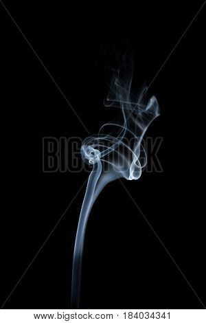 wavy white smoke on a black background