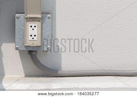 White Electrical Outlet Or Plug Housing With Waterproof Cover At Outdoor.