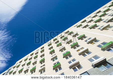 The facade of the new residential high-rise buildings against the sky . The concept of building a typical residential neighborhood