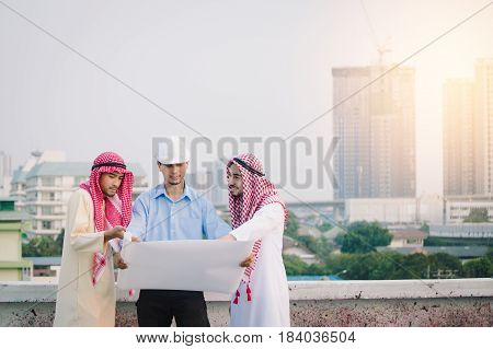 Muslim Business And Engineer Working Concept: Engineers And Two Muslim Businessman Discussing About