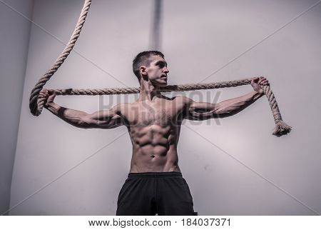 Man Arms Extended Holding Rope Bodybuilder