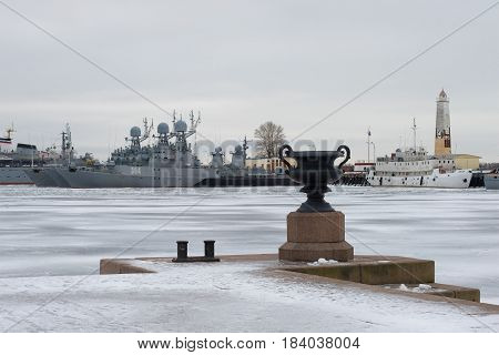 SAINT PETERSBURG, RUSSIA - JANUARY 25, 2017: View from the Petrovsky pier to the parking lot of the warships of the Baltic Navy on a gloomy January day. Kronstadt