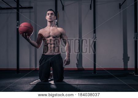 One Young Man, Bodybuilder Kneeling Ball