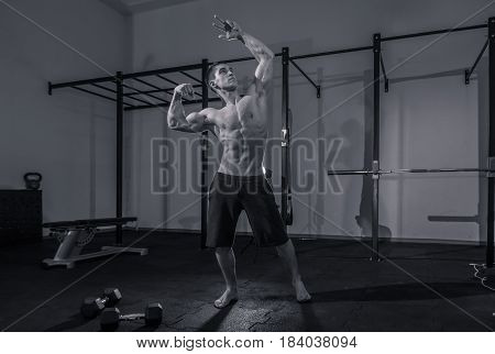 One Young Man, Bodybuilder Muscular Shirtless, Dark Gym Indoors