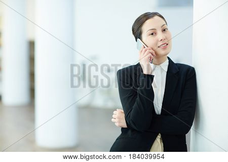 Young businesswoman talking on cellphone