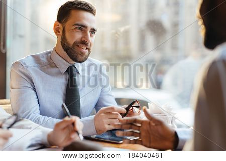 Confident employer talking to candidate for vacancy