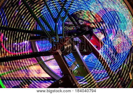 Abstract play of light with lights in bicycle wheel spokes.