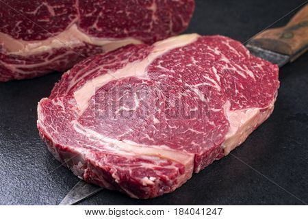 Raw dry aged Kobe Entrecote Steak as close-up on a slate