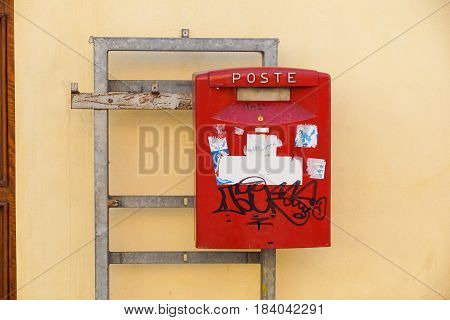 ITALY - January 32, 2017: View of a traditional Mail red pillar box outside a Post Office. Founded in 1516 Royal Mail iconic post boxes are ubiquitous throughout italy .