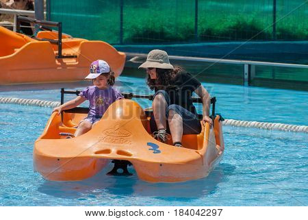 Mom And Daughter On Pedal Boat At Mini Israel - A Miniature Park Located Near Latrun