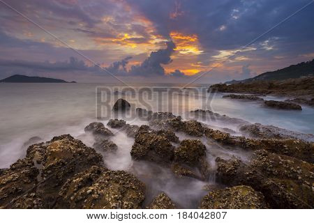 Seascape with rock in beautiful sunset scenery backgroundlong exposure style