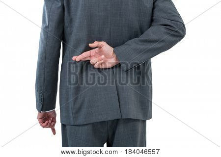 Businessman standing with figure crossed against white background