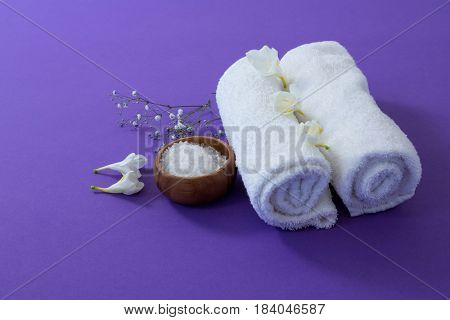 Set of spa accessories on purple background