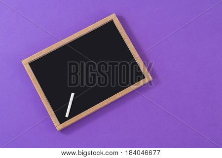Slate with chalk on purple background