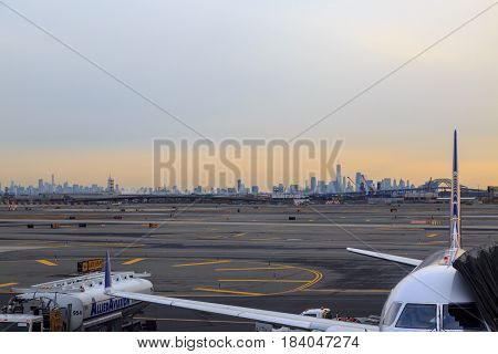At newark airport newark NJ - December 31 2016: United airlines airplane in the newark airport with new york silhoutte