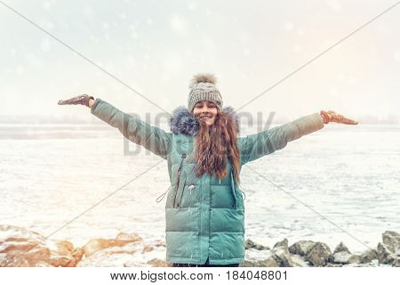 Young Girl In A Winter Park Near River