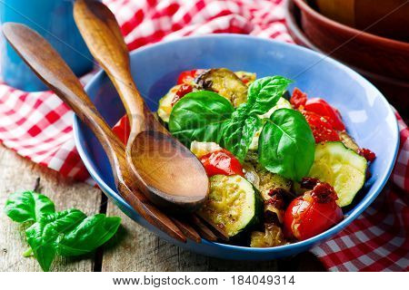 Microwave Ratatouille in to blue bowl.style rustic.selective focus