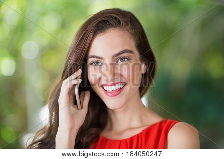 Beautiful woman smiling while talking on her mobile phone