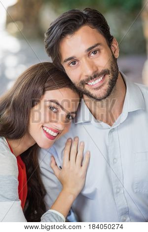 Portrait of woman resting her head on mans shoulder in the restaurant