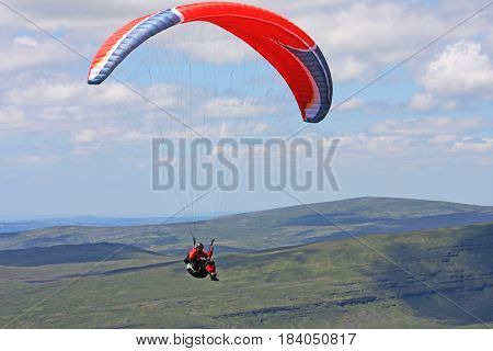 Paraglider flying wing in the Brecon Beacons