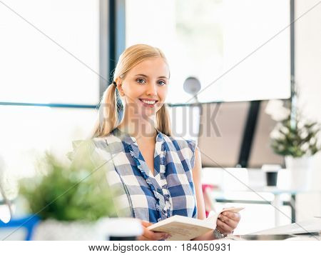 Portrait of smiling female office worker