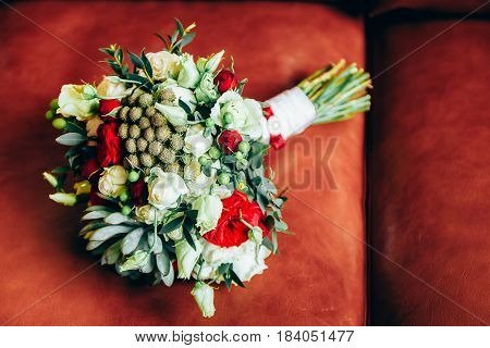 Wedding bouquet of white roses laying in fresh