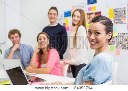 Portrait of smiling executives in office