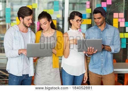 Attentive executives discussing over laptop in office