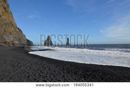 Waves crashing ashore of Reynisfjara beach in Vik Iceland.