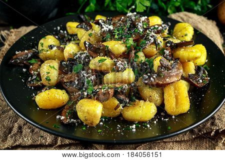Home made potato gnocchi with mushrooms, chopped parsley and parmesan cheese.