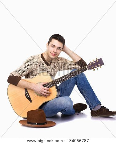 Guy Musician With Guitar Sitting Against White Background