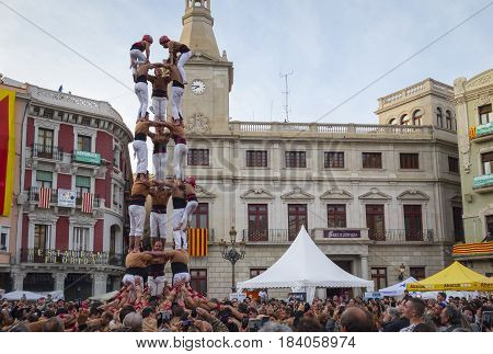 REUS, SPAIN - APRIL 23, 2017: Castells Performance in the Sant Jordi day, a castell is a human tower built traditionally in festivals within Catalonia. This is also on the UNESCO Cultural Heritage
