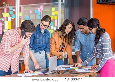 Team of graphic designers discussing in a meeting at office