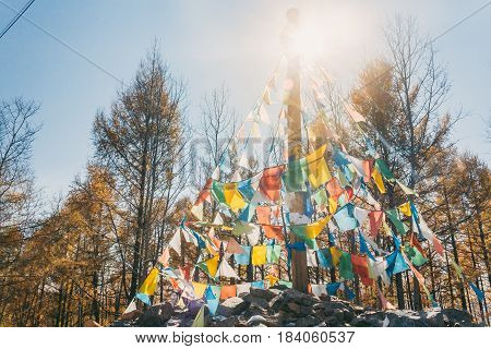 Colourful Obo And Aobao Landscape In Mongolia ,mongol Totem, In Forest With Blue Sky,horizontal