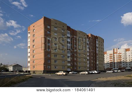 Modern multi-storeyed house with flats. Was built from yellow and orange color