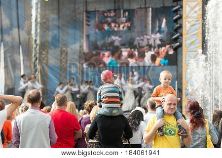 RIGA LATVIA - AUGUST 17 2014: People on the streets of Riga City Festival. Festive concert.
